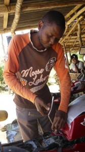 Hamisi Kanona repairs a bike